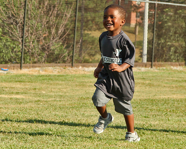 Bitty baseball player running