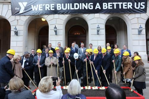 Photo: Donors, partners and leaders turn shovels in a ceremonial groundbreaking for the Downtown YMCA