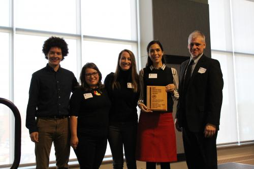 Five staff and volunteers representing the Cleaver Family YMCA Togetherhood program hold the award plaque they received from the Southtown Council for volunteer service.