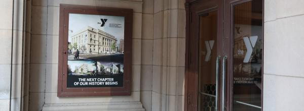 Renderings of the new Y decorated the entrance to the lobby of the historic building.